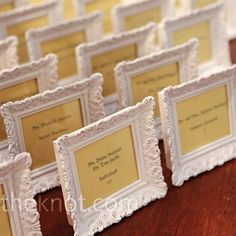 Vintage style frames found at Michaels craft store and used as cardholders (for seating/table assignment) and doubled as favors