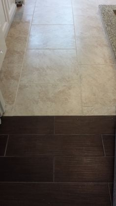 Nice transition from porcelain floor that looks like wood in the master bedroom to travertine floor in the master bathroom.