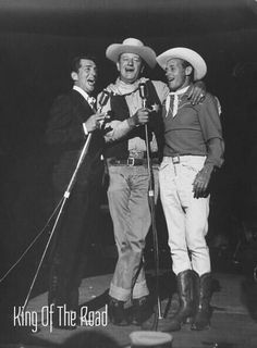 KINGS OF THE ROAD - Dean Martin, John Wayne & Guy Madison perform on stage for a charity event in California.:
