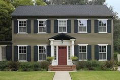 best exterior colors for colonial revival houses green clapboard house with dark shutters