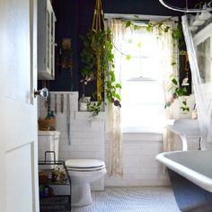 Ideas for how to transform your boring bathroom into a mini indoor garden. (Image: Apartment Therapy)