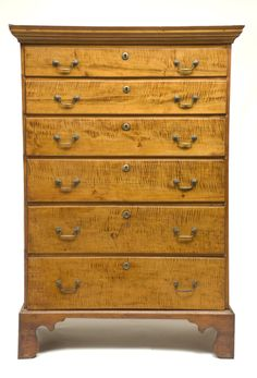 """18TH C. NEW ENGLAND TALL CHEST Tiger maple, maple and chestnut secondary wood, dovetailed case, finely detailed applied molding over six lipped and thumbnail molded graduated drawers, in highly figured tiger maple, original brass bail pulls (on top five drawers) and round escutcheons, on a maple wood molded and cutout bracket base, shows restoration, old refinish condition, from a Milton estate, 4' 11"""" h, 36"""" w, 19"""" d."""