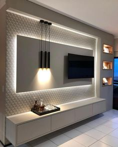 5 Amazing Ways to Upgrade Your Living Room TV Wall - Are you bored with the same old flat screen arrangement? Then why not try one of these five amazing ideas for your living room TV wall. Tv Unit Decor, Tv Wall Decor, Wall Tv, Tv Wall Panel, Bedroom Tv Wall, Bedroom Wall Designs, Wall Decor Lights, Wall Shelving, Kitchen Ceiling Lights