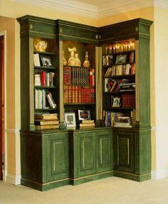 Real leather backed false books, front the drinks cupboard in the middle shelves of the built in corner bookcase that Simon Spencer designed in this illustration.