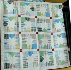 - Memory Quilt- Made from husbands old work shirts.-  <3  so sweet.  maybe if i get good i;ll do one like this too!