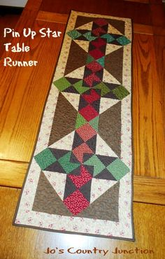 Friday Finish: Pin Up Star Table Runner and Free Pattern-by Jo. We came up with a block that we really liked with a pinwheel inside a star....The table runner is pretty big.  It ends up being 17″ x 53″.  I think it will look nice on the table in the house in town.  There I will be able to keep all of the leaves in the table thus supporting a large runner.