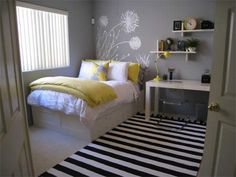 Cute bedroom. Love the yellow splashes through the pillow etc on the bed. And love the striped mat.