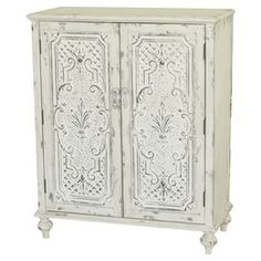 """2-door chest with scrolling detail and a weathered white finish.  Product: ChestConstruction Material: HardwoodColor: Weathered whiteFeatures:  One adjustable shelfTwo doors Dimensions: 41"""" H x 36.75"""" W x 18.25"""" D"""