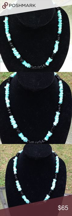 """Amazonite and Black Tourmaline Gemstone Necklace Featuring gorgeous shades of light blue and turquoise contrasted with striking black, this lovely necklace is a perfect statement piece. This piece is made with natural amazonite and black tourmaline. It measures 22"""" long and attaches in the back with a rhinestone studded toggle clasp. All PeaceFrog jewelry items are made by me! Take a look through my boutique for coordinating jewelry and more unique creations. PeaceFrog Jewelry Necklaces"""