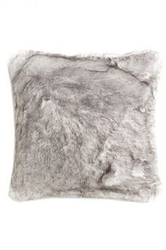 A grey faux fur cushion cover is just one of the many finds interior designers are buying from Zara Home (and we love them all)!