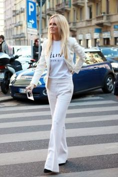 Street style perfection! White suit paired with a casual tee.