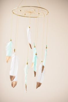 This gorgeous mint and white feathers dream catcher mobile will make all your dreams come true :) This mobile can be hung over a crib, changing