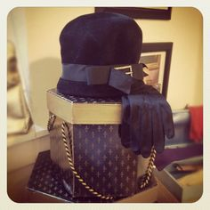 Lovely vintage black at, gloves and hat boxes!