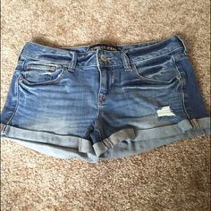 Express distressed shorts Light wash express low rise distressed shorts with rolled hem. Brand new without tags no trades Express Shorts