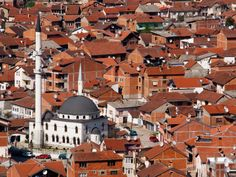 Photo about A white mosque between the red houses in the city of Prizren in Kosovo. Image of kosovo, eastern, visit - 20281860 Photos For Sale, Stock Photos, Site Face, Red Roof House, Visit Albania, Viking River, Red Houses, Romanesque, Eastern Europe