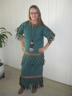 This design can be done in buckskin (shown here in a faux suede) it is a 2 piece set that includes a top and matching skirt...it is fringed at the sleeve, around the bottom of shirt and features a low waist line and the skirt is fringed around the bottom. Pictured here made of Faux suede but can very easily be made of buckskin.