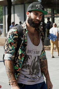 Grey Tank Top styled with Floral Shirt, Blue Ripped Jeans and complete the oufit by wearing Grey Sneakers
