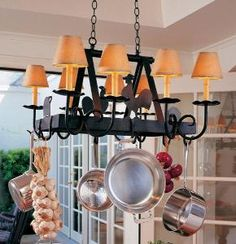 Handmade Iron Pot Rack with Animals and Candelabra  from The Well Appointed House www.wellappointedhouse.com