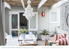 kleinmond beach house decor 008 Kleinmond Beach Cottage {Home Tour} Like the coral-ish stripe cushions