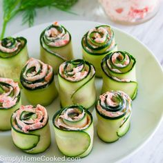 These smoked salmon cucumber rolls look very elegant yet super simple to make. All you need is 4 ingredients to make these lovely appetizers. Their subtle flavor make it easy to serve with almost any meal.  Ingredients:  8 oz cream cheese, softened  1 large cucumber  1 tbsp dill, chopped  3