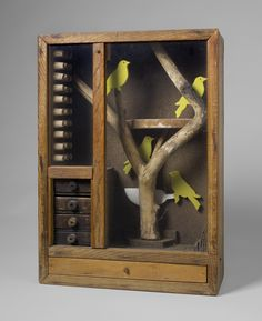 """Joseph Cornell, """"Untitled (Aviary with Yellow Birds),"""" c. 1948. Hirshhorn Museum and Sculpture Garden, Smithsonian Institution, Washington DC. © The Joseph and Robert Cornell Memorial Foundation/Licensed by VAGA, New York. Photo: Cathy Carver Visit hirshhorn.si.edu to view more works in the exhibition """"At the Hub of Things: New Views of the Collection."""""""