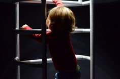8/52 52 Project / mummy karma blog / practising simplicity / living arrows / photography / Nausicaa Boulogne Aquarium / dramatic light / boy climbing