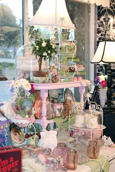 Pink and green vintage and new teacups, cakes and florals merchandising display.  www.violetcottage.com