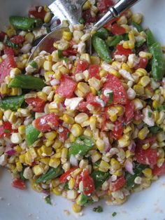 Summer Corn Salad made w/ fresh corn, tomato, red onion, feta, snap peas. Subbed cilantro for herbs and did a honey lime vinegrette. This was perfect with our shrimp tacos.