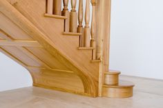 The finish to this bespoke timber staircase is to an exceptional standard and decorative detail has been carved underneath.