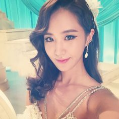 Yuri shared pretty photos from the set of SNSD's 'Lion Heart' MV
