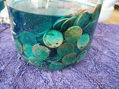 DIY Wood Stain! Soaking pennies from the 60's and older in vinegar produce a caribbean blue stain! How cool!