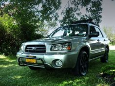Crystal Gray 05 XS with rally innovations light bar and roof basket, black plastidipped rims #outdoorsubarus