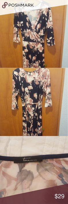 Maxi wrap dress Super soft maxi dress. 3/4 sleeve. This wrap dress has no tags. It has not been worn or washed. Beautiful navy color with pink flowers. Tua Dresses Maxi