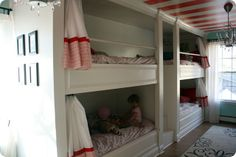 Built in bunks for multiples! Look at those cute privacy curtains! LOVE the red and turquoise!