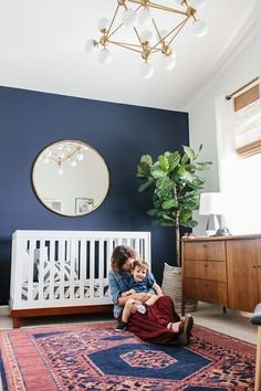 Elegant nursery with a navy accent wall