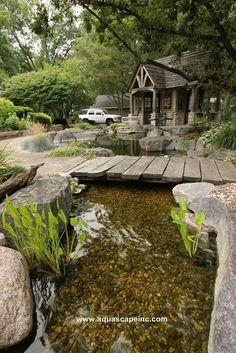 A rustic footbridge provides access from the lower patio over a stream.Here you can dangle your feet and cool your tootsies. Backyard Stream, Garden Stream, Backyard Water Feature, Ponds Backyard, Garden Ponds, Koi Ponds, Backyard Waterfalls, Gravel Garden, Pea Gravel