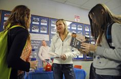 Waterloo students Katelyn Hanna (left) and Jayde Gough (right), both 14, talk to Heather Coburn. They hold copies of Heather's book The Perfect Imperfect Me.