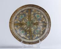 A Kashan bowl Iran, Kashan, early 13th Century Fritware painted with cobalt blue and lustre on opaque white glaze
