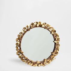 Rectangular mirror with golden leaves
