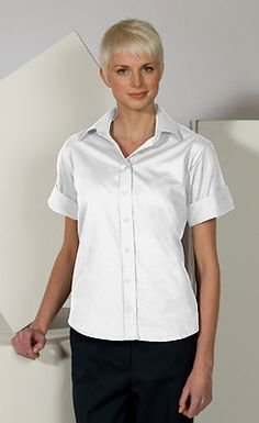 Ed Garments Women's Wrinkle Free Open Neck Poplin Blouse Shirt. 5245 Description  65% Polyester/35% Cotton; 3.5/3.75 oz. wt., Short sleeve blouse with open neck, Contoured side seams and two back darts, Narrow placket with matching buttons, Machine washable and wrinkle resistant.