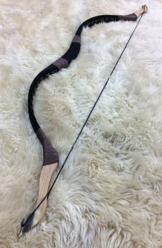 """48# at 28"""" draw. Black suede leather limb covering with dark brown stitching and black grip. Ash tips with horn laminate tips and NO STRIKE PLATES on bow (If you wish strike plates please indicate so in the """"Notes to Sender"""" section when purchasing).*ambidextrous"""