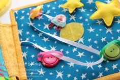 Great threading idea (page also has press stud stars & hidden rocket in zip pouch)