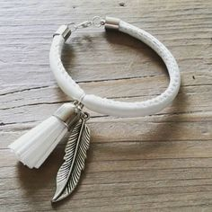 Check out this item in my Etsy shop https://www.etsy.com/uk/listing/244085059/white-leather-bracelet-with-charm-tassle