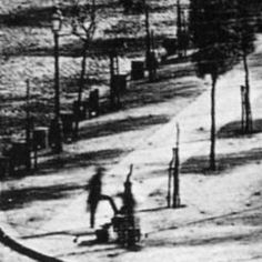 "First photograph of a human C.1838. ""Boulevard du Temple"", taken by Daguerre in late 1838 or early 1839 in Paris, was the first photograph of a person. The image shows a street, but because exposure time was over ten minutes, the traffic was moving too much to appear. The exception is the man at the bottom left, who stood still getting his boots polished long enough to show."