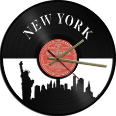 "Clock made from vinyl 12"" single or album.  These are suitable for wall mounting   Available for your consideration is a wonderful upcycled vinyl r..."