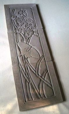 Val Webb pottery carving nouveau lines ceramics clay orchid butterfly tile
