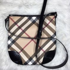 Authentic Burberry Supernova Check Cross body Bag Authentic Burberry Supernova Check Cross body Bag. Adjustable patent leather shoulder strap with leather trim. L 10.5 x W 10.75. Only used a few times perfect for every day! Burberry Bags Crossbody Bags