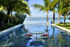 Key West, tropical gardens, water features, swimming pools, palm trees, island living, hardscape, landscape design