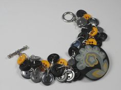 Hey, I found this really awesome Etsy listing at https://www.etsy.com/listing/127957667/sweet-honey-bee-button-bracelet-gray