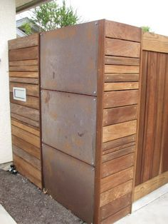 horizontal wood & corten steel fence